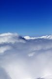 Mountains under clouds and clear sunny sky Stock Photography