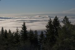 Mountains under clouds in winter. Norway mountains and forest. Blue sky Royalty Free Stock Photo
