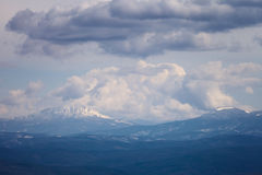 Mountains under the cloudy sky Royalty Free Stock Image