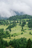 Mountains under a cloudy sky in sunny day Stock Photos