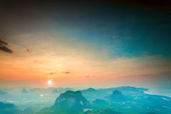 Mountains under colorful sky in sunset Stock Photo