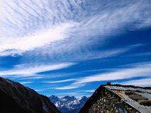 Mountains under feathery clouds. In Nepal Stock Photography