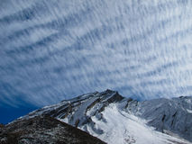 Mountains under feathery clouds. In Nepal Royalty Free Stock Images