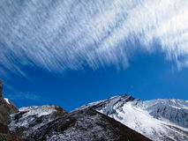 Mountains under feathery clouds. In Nepal Stock Images