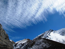 Mountains under feathery clouds. In Nepal Royalty Free Stock Image
