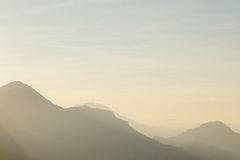 Mountains under the fog Royalty Free Stock Image