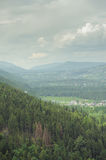 mountains under mist in the morning and city in the valley Stock Photography