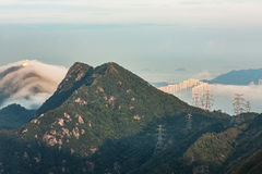 Mountains under mist in the morning Royalty Free Stock Photos