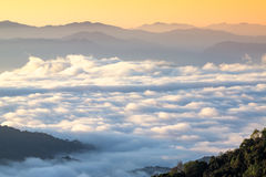 Mountains under mist in the morning Royalty Free Stock Images