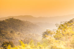 Mountains under morning light. Mountains in the yellow tone, Udonthani, Thailand Royalty Free Stock Photo