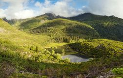 Mountains under the name Dusse Alin in Russian Far East Khabarovsk region. Beautiful Mountain Lake is called the Bear in the. Mountains Dusse Alin royalty free stock photos