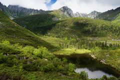 Mountains under the name Dusse Alin in Russian Far East Khabarovsk region. Beautiful Mountain Lake is called the Sealin the. Mountains under the name Dusse Alin royalty free stock images