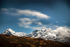 Mountains under night sky with stars Royalty Free Stock Photo