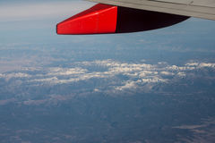 Mountains Under a Plane Wing Royalty Free Stock Photo
