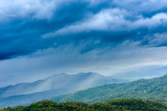 Mountains under rain clouds Royalty Free Stock Photo
