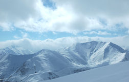 Mountains under the snow. In the winter Royalty Free Stock Image