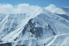 Mountains under snow. In winter Royalty Free Stock Photos