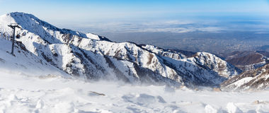 Mountains under the snow in winter. Panorama of snow mountain range landscape. Stock Image