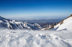 Mountains under the snow in winter. Panorama of snow mountain range landscape. Royalty Free Stock Photography