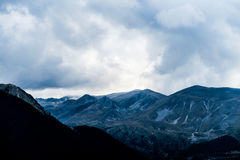 Mountains Under White Cloudy Sky Stock Photo