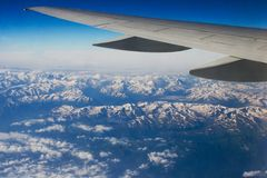 Mountains under the wing. Snowy Caucasus mountains under the wing Stock Photography