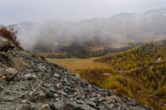 Mountains valley autumn fog top view Royalty Free Stock Photo
