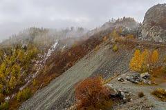 Mountains valley autumn fog top view Stock Photos