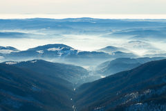 Mountains valley with gentle haze above it Stock Photography