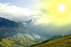 Mountains valley in a rays of sun Royalty Free Stock Photo