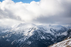 Mountains view in sunlight with clouds Royalty Free Stock Photos