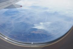 Mountains viewed from airplane somewhere above USA. Mountains viewed from airplane window somewhere above USA stock images