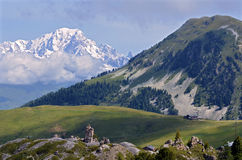 Mountains views of La Plagne in France. Mount Saint-Jacques and snowy Mont Blanc massif in the background at La Plagne, commune in the Tarentaise Valley,Savoie Stock Image