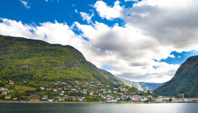 Mountains, village and Norwegian fiord Royalty Free Stock Photo