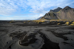 Mountains and volcanic lava sand in Stokksness, Iceland Stock Photography