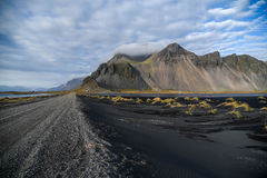 Mountains and volcanic lava sand in Stokksness, Iceland Royalty Free Stock Photography