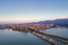 Mountains-water city in sunset Royalty Free Stock Photo