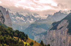 Mountains of Wengen. Mountains with snow in the swiss Alps of Wengen, in a valley on a cloudy day Stock Image