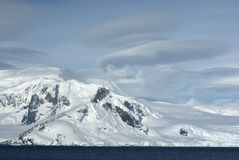 Mountains of western Antarctic Peninsula in cloudy day. Royalty Free Stock Photos