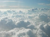 Flying over cotton-like clouds. Mountains of white clouds touching the sky. Infinity in the sky, white clouds like a sweet bed in heaven, love is in the air Stock Photos