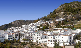 Frigiliana with mountains Stock Images