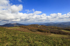 Mountains and White Puffy Clouds Stock Image