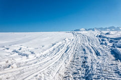 In the mountains, winter landscape. Photography in the mountains in winter. Beautiful blue sky and mountains in the snow. The road, which roam the people Stock Images