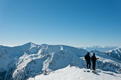 In the mountains, winter landscape. Photography in the mountains in winter. Beautiful blue sky and mountains in the snow. The road, which roam the people Royalty Free Stock Photography
