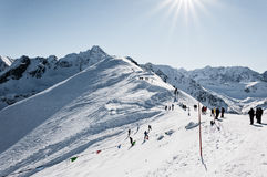 In the mountains, winter landscape. Photography in the mountains in winter. Beautiful blue sky and mountains in the snow. The road, which roam the people Royalty Free Stock Image