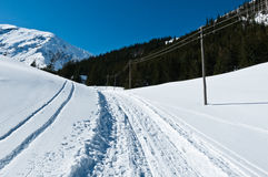 In the mountains, winter landscape. Photography in the mountains in winter. Beautiful blue sky and mountains in the snow. The road, which roam the people. House Stock Photography
