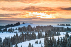 Mountains in winter at sunset Royalty Free Stock Photos