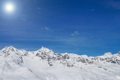 Mountains With Snow And The Blue Sky Stock Photos