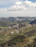 Mountains of Zahara in vertical. Mountains of Zahara de la sierra with some trees located in the Spanish province of Cadiz, on a clear day. It´s a vertical Royalty Free Stock Image
