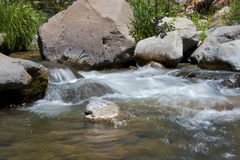Mountainside creek Stock Images