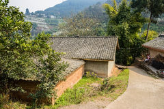 Mountainside farmhouses in sunny spring Stock Photography